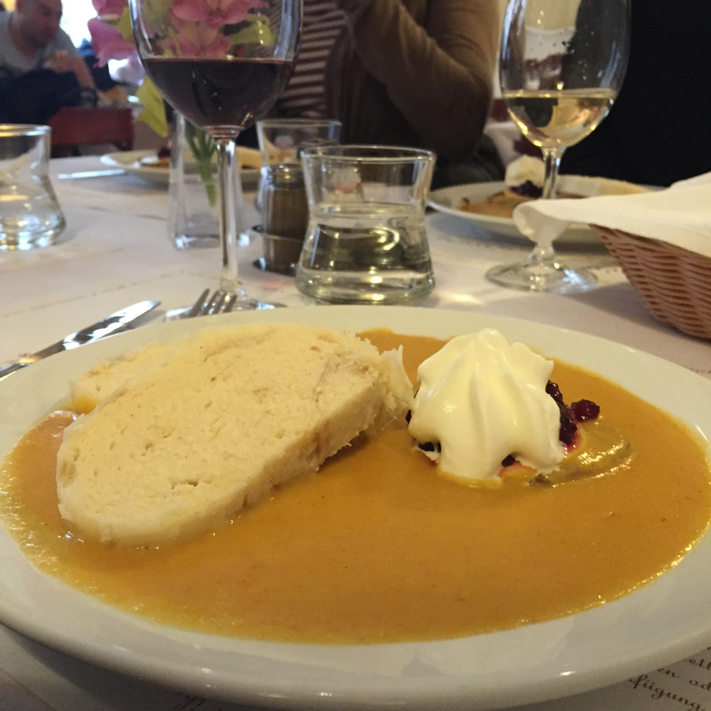 Cafe Louvre: Sirloin beef with cranberry jam served in soup like carrot gravy with potato dumplings and sour cream.