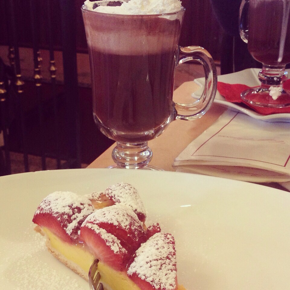 Bicerin is the warm drink of choice for the Torinese - hot chocolate plus a shot of coffee, topped with freshly whipped cream. Served here with a strawberry custard tart at the historic Clarissa cake shop