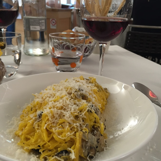 A lunch feast at La Bottega del Vicoletto in Alba. Tajarin (the local style egg pasta similar to tagliolini) are served here with black truffle and butter sauce